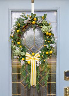 DIY Artichoke Lemon Wreath #wreaths #summercraft #summerdecor #lemon #lemondecor #sandandsisal