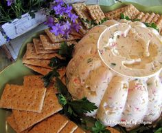 Shrimp or Crab Dip -- this is so good it will make you slap your mama!!! (I make it with shrimp.)  This recipe needs some extra seasoning, though.Maybe Emeril's Cajun seasoning or Old Bay,