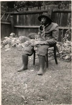 Just a dog dressed as a man with his pet cat.