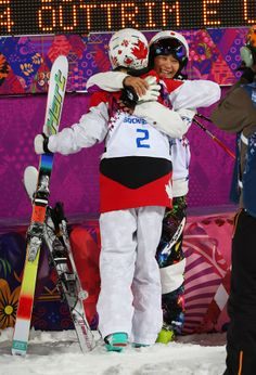 Aiko Uemura of Japan congratulates Justine Dufour-Lapointe of Canada during the Ladies' Moguls Final 3 on day one. Freestyle Skiing, Aiko, Olympic Games, Olympics, Athlete, Canada, Japan, Baseball Cards, Sports