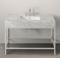 RH's Hudson Metal Single Extra-Wide Washstand:We looked to the last century to inform our collection's aesthetic, creating an open-back sink and matching storage with the minimalist lines of the 1950s.