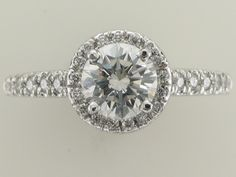 New custom made halo style engagement ring with a 1ct round center diamond in platinum