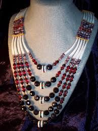 Dentalium shells with glass bead necklace.