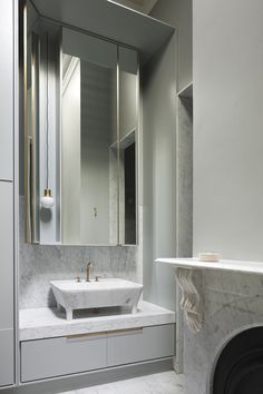 Historical detail meets modern glamour in this beautifuly renovated bathroom by Hecker Gutrhrie. Photo by Shannon McGrath.