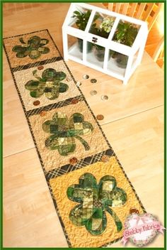 Patchwork Shamrock Table Runner Kit: Share the luck of the Irish with this St. Designed right here at Shabby Fabrics by Jennifer Bosworth, this runner features patchwork shamrocks and some metallic gold accents. Runner finishes to 12 Patchwork Table Runner, Table Runner And Placemats, Table Runner Pattern, Quilted Table Runners, Quilting Projects, Sewing Projects, Day Runner, Place Mats Quilted, Shabby Fabrics
