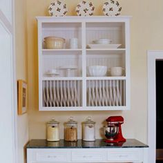 Shelf for plates above kitchen table