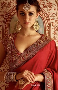 Blouse designs A brief intro for some of gorgeous bridal blouse designs.A brief intro for some of gorgeous bridal blouse designs. Indian Blouse Designs, Bridal Blouse Designs, Saree Blouse Designs, Pakistani Bridal, Indian Bridal, Indian Wedding Wear, Indian Dresses, Indian Outfits, Sabyasachi Sarees