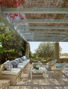 Willow panels shade the pool pavilion as bougainvillea blooms overhead   archdigest.com
