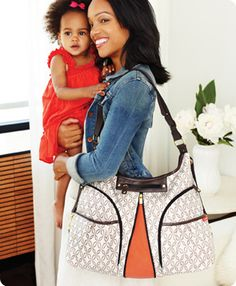 The high-style Versa diaper bag keeps up with you and baby through errands, playdates, work and even the gym. Two insulated front pockets are roomy enough to store baby's bottles, sippy cups and food. Nine more pockets easily organize diapers, toys, clothes and all of your personal items – keeping everything safe and dry. A quick zip down the center provides over 20 percent more storage capacity. $70.