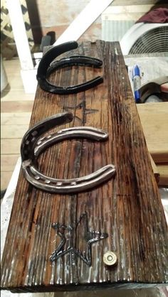 Horse shoe coat rack...is that a bullet casing?! So love this!