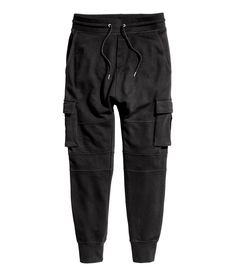Check this out! Joggers in sweatshirt fabric. Elasticized drawstring waistband and dropped gusset. Side pockets, and leg pockets and back pocket, all with flap and hook-loop fastener. Tapered legs with seams at knees and ribbed hems. - Visit hm.com to see more.