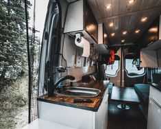 I really like the layout of this diy mercedes sprinter van conversion. The design looks super rustic and it has an awesome kitchen and bathroom layout. It's one of my favorite #vanlife adventure builds for travel!