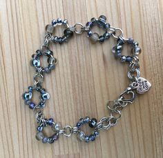 A personal favorite from my Etsy shop https://www.etsy.com/listing/534520361/chainmaille-bracelet-beaded-bracelet