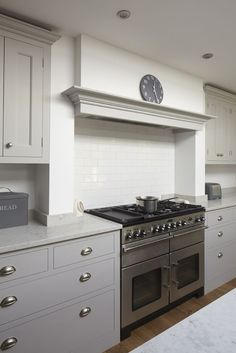 Traditional painted kitchen in Hinchley Wood, Surrey featuring a larder, Teltos Carrara worktop, Rangemaster cooker and canopy. Range Cooker Kitchen, Kitchen Hoods, Kitchen Stove, New Kitchen, Kitchen Cabinets, Kitchen Extractor Hood, Kitchen Ranges, Kitchen Ideas, Shaker Cabinets