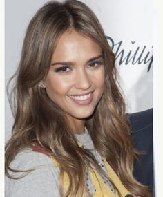 To get this look, ask your colorist: For a light, ash brown base with honey highlights and caramel brown lowlights placed throughout the hair. Also, you should request that the color transitions to lighter tones towards the ends to add depth and definition.
