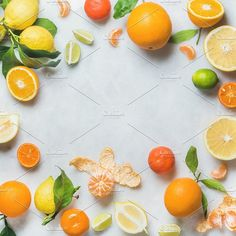 #Variety of fresh citrus fruit  Variety of fresh citrus fruit for making juice or smoothie over light grey marble table background top view copy space square crop. Healthy eating vitamin detox diet food clean eating concept