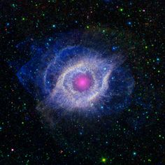 Eye of Aquarius: The Helix nebula resides in the constellation Aquarius about 700 light-years away. It's quite large - its main ring is 2 light-years across, although its material spreads out to 4 light-years. The star at its center is evolving to become a white dwarf. This image shows the nebula in the infrared light spectrum, which is invisible to the eye and more toward heat radiation.