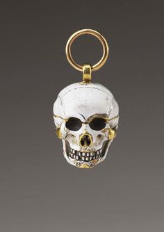 Skull Pendant with Entombed Skeleton, 17th century. Gold, enamel, diamonds. British or Dutch.