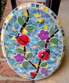 Cute hand painted ceramic lady bugs with stained glass accents.
