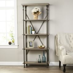 Display framed family photos and leather-bound tomes on this essential bookcase, perfect in the study or den.