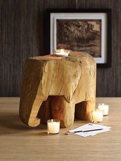 I think it's time we addressed the wooden elephant candle holder in the room. Wooden Elephant, Elephant Table, Elephant Lamp, Elephant Stuff, Dot And Bo, Home And Deco, Wood Carving, A Table, Home Accessories
