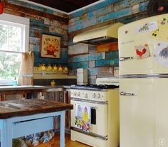 Reclaimed wood kitchen walls, Big Chill yellow appliances.