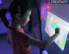 Children can color their own fish via touchscreens and bring them onto large projection wall.