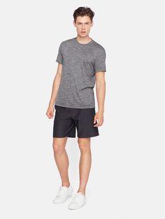 Minimalist men navy shorts | Minimalist men grey t-shirt | Minimalist men style | Minimalist sportswear for men | Minimalist activewear for men | Capsule wardrobe | White trainers | Slow fashion | Simple style | Less is more