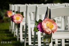 Bold and vibrant colored peonies flower decor on ceremony aisle designed by Intrigue Design and Decor. Kent Manor Inn, Kent Island, Eastern Shore Maryland, wedding ceremony and getting ready photos, by wedding photographers of Leo Dj Photography. http://leodjphoto.com