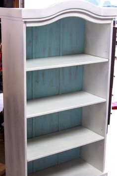 I love the paint colors she used on this book shelf!!! Pin for