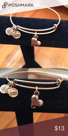 Alex and Ani Bangle--Gold Never worn bangle. Heart charm. Gold color. Alex & Ani Jewelry Bracelets