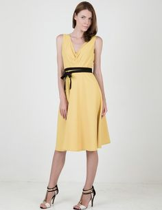 sleeveless dress in yellow - $63 by ClubCouture | dress: sleeveless midi dress in a pale yellow shade, features a flattering chevron pleating at the front of the bodice, circle skirt and removable black waist tie.   overview: cotton, polyester measures 35in from shoulder model height: 1.79m hand wash cold, hang or line dry | #Dresses
