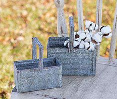 """Weight - 1.00 lbs. Height - 7.50 in. Width - 4.25 in. Length - 6.75 in. Washed Galvanized Baskets sell as a set of two weathered metal containers with corrugated, textured sides. Each basket includes a square carrying handle. Small size measures 5¾"""" wide by 3"""" deep and 3"""" high (6"""" high with handle). Large size measures 6¾"""" wide by 4"""" deep and 4¼"""" high (7½"""" high with handle). Weathered, Washed Galvanized Baskets are industrial storage containers that are great for displaying florals, or…"""