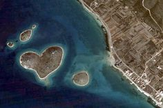 A tiny island in the Adriatic has become a holiday hit for lovers because it is shaped like a heart. The 130,000 square yard islet of Galesnjak came to prominence after its unusual shape was highlighted on Google Earth. Even the owner of the uninhabited island - now known as Lovers' Island - didn't realise how perfectly heart-shaped the island off the Croatian coast was until he was swamped with requests from couples to stay there....
