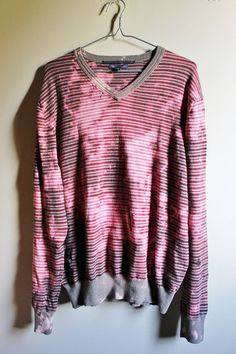 Each bleached and shredded sweater is unique, a one of a kind.  This one is a…