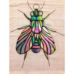 Stained glass fly. Holana Glass.