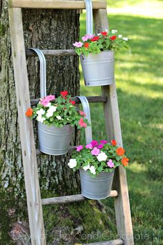 Jazz up your old planters with spray paint and your imagination!