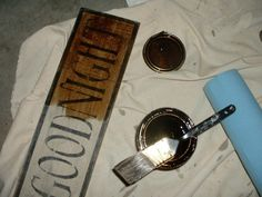 how to make your own primitive looking signs.  She uses stencils, acrylic paint, stain, and 6″ boards