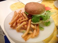 Burger King self made, fried potatoes and salad.