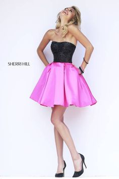 Rows of black metallic sequins line the strapless bodice above a circle of flirty fuchsia satin. This is the ultimate party dress.