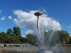 The Space Needle towering over a fountain in Seattle Center. | Yelp