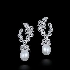 Beautiful Diamond Earrings with Pearl.