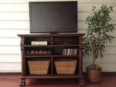 Old claw foot dresser repurposed into an entertainment center. By Repurposed Creations
