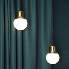 Mass Lights from &tradition in brass and Kvadrat curtain by Norm Architects