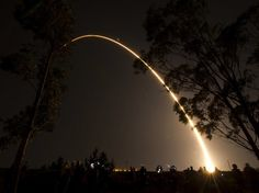An arc of light illuminates the sky at Vandenberg AFB California as a Delta II rocket launches with the NPOESS Preparatory Project spacecraft payload.