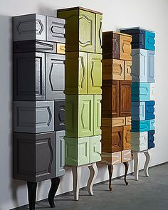 Re-purposing cabinet faces in a sophisticated way. The monochromatic color schemes help keep the different faces tied together. (site not in English)