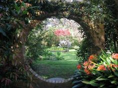 "Circular garden entrance otherwise known as a ""moon gate"". Dream Garden, Garden Art, Garden Design, Garden Frame, Amazing Gardens, Beautiful Gardens, Beautiful Moon, Magical Gardens, The Secret Garden"