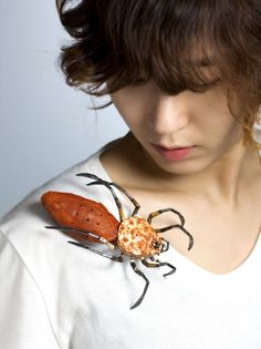 Yojae Lee. Brooch: Insects_ spider, 2014. Frog's skin, crab's shell, leather, sterling silver, polymer clay. 8 x 14 x 3 cm.