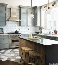 Designer SuzAnn Kletzien transformed this Chicago kitchen with new fixtures and mixed metals, unifying the space with gray and white — plus hints of brass. Willamette pendants illuminate the island, while above the bay window, Isaac sconces focus light on the sink. Recessed lights, in combination with lights inside and under the cabinets, add to the glow. Click through for more of the best kitchen lighting ideas.