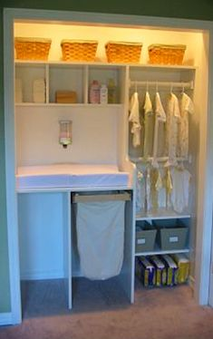 Nursery closet idea - love the changing table in the closet and LOVE how organized this baby closet is!
